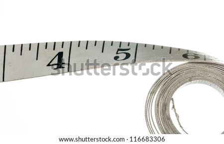 Measuring tape with inches made of cloth and isolated against white background