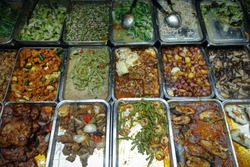 Meat and Vegetable Filipino Foods in Trays at Market Eatery in Philippines