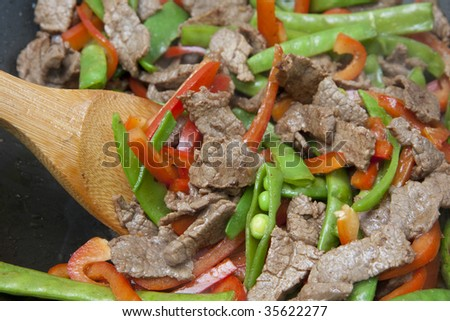 Meat and Vegetable stir-fry being cooked in wok