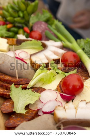Meat and vegetables on a wooden table prepared for festivity. Stock photo ©