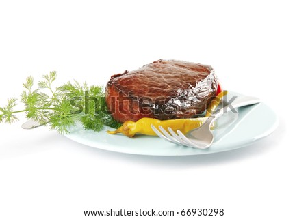 meat and vegetables on blue dish with pepper