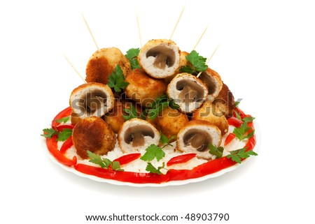 meat balls chicken fillet stuffed with mushrooms, a side dish of rice with red pepper isolated on white