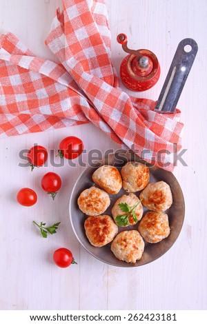 meat balls (cutlets) from turkey meat in a frying pan