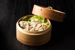 Meat dumpling in bamboo steamer