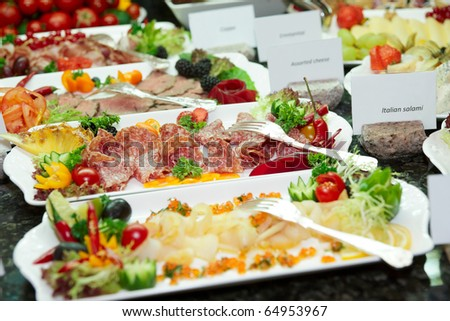 Meat, fish and fruits in expensive hotel restaurant