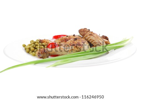 meat food : roast chicken garnished with green onion and red chili hot pepper on white plate isolated over white background