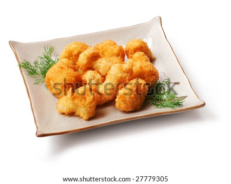 Meat fried in batter with dill in squared plate over white background