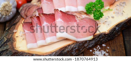 Meat, ham with herbs and spices on wooden background, closeup. Photo stock ©