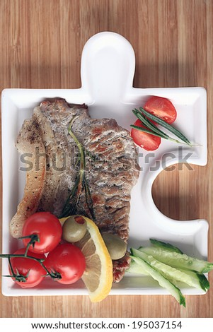 meat in an unusual serving plate