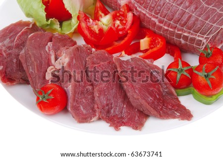 meat in grid with tomatoes on white