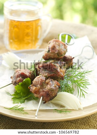 Meat kebab with dill and parsley, selective focus
