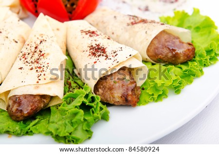 Meat kebabs wrapped in pita