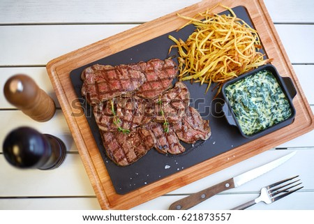 Meat on wood with potato and sauce Stok fotoğraf ©