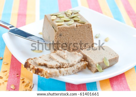 Meat paste made as small loaf with pumpkin seeds