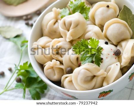 Meat pelmeni with sour cream. Selective focus