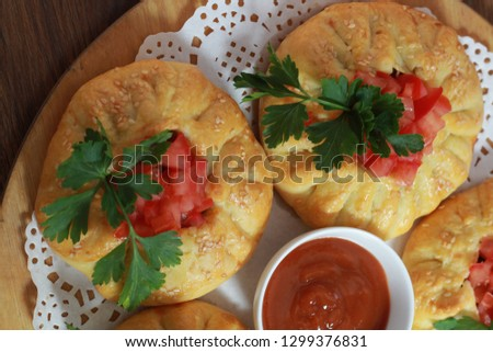 Meat pie with ketchup. National dishes, khinkali and manti