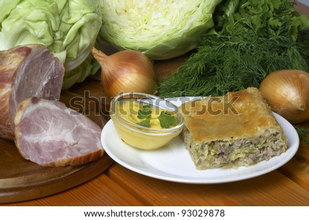 meat pie with vegetables and sauce