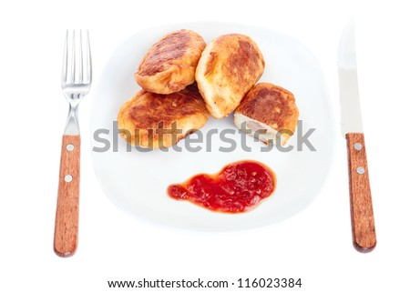 Meat pies on a plate for lunch. On a white background.
