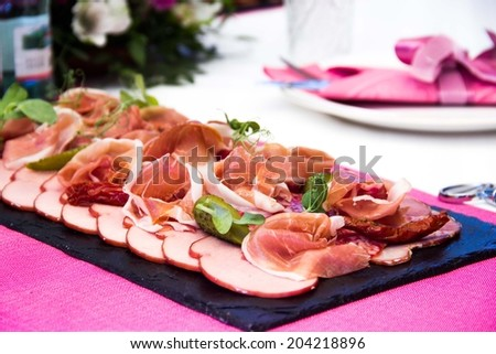 Meat plate on table, snacks for party, elegant presentation