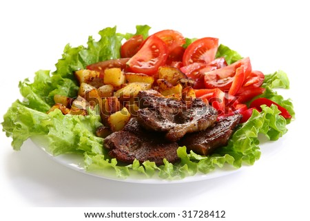 Meat plate with potatoe and souce