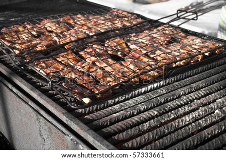 Meat pork on a italian festival barbecue grill
