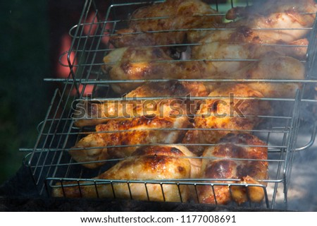 Meat roasted on coals on a spindle, barbecue, shish kebab. a dish of marinated meat and vegetables.