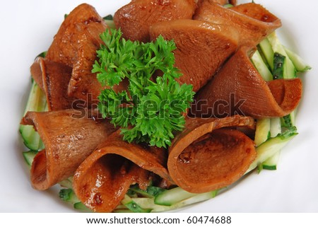 Meat rolls with parsley and cucumbers - stock photo