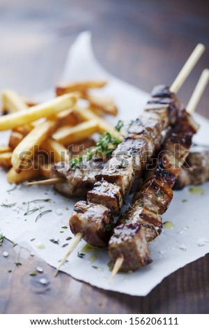 meat skewer with herbs lime and pita bread