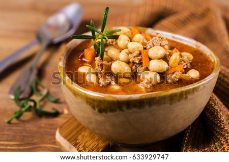 Meat soup with beans and vegetables. Selective focus #633929747