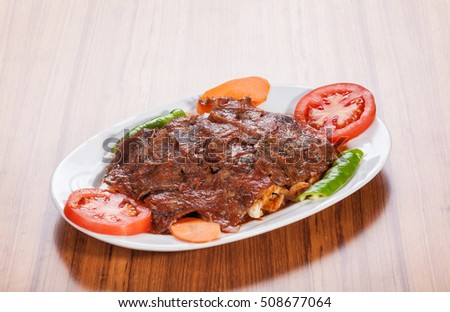 Meat stew served with melted cheese on wooden table #508677064