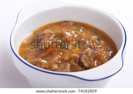 Meat stew with vegetables and herbs