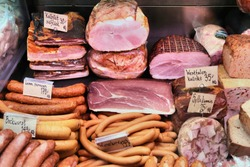 Meat store in Gothenburg Market Hall (Saluhallen), Sweden. Various smoked hams, bacons, sausages, wieners and brawn (sylta).