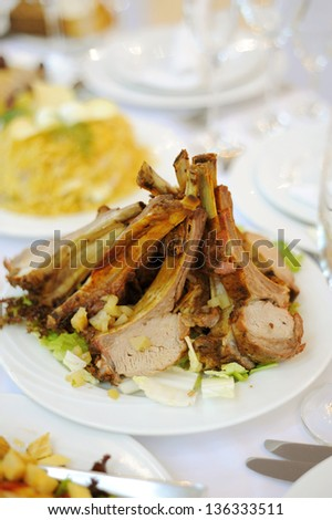 meat with bones on plate in restaurant