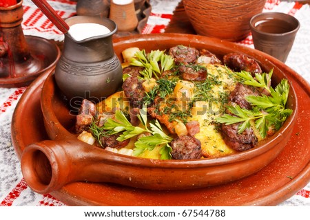 meat with potatoes in the pot