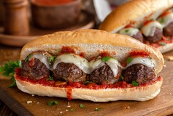 Meatball sandwich with tomato sauce and cheese on a hoagie roll