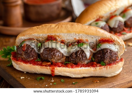Meatball sandwich with tomato sauce and cheese on a hoagie roll ストックフォト ©