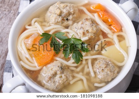 Meatball soup, noodles with vegetables on the table close-up. view from above.