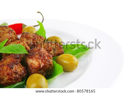 meatballs and vegetables with basil and vegetables
