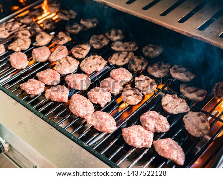 Meatballs on the grill. Barbecue grill.  #1437522128