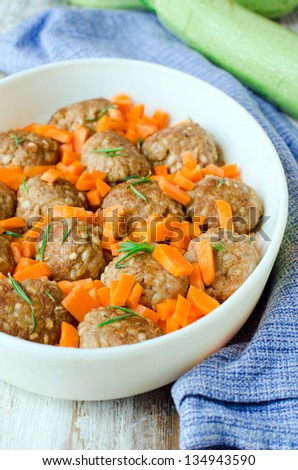 Meatballs with barley, selective focus