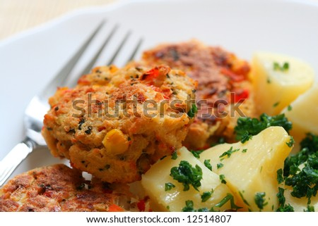 Meatballs with potatoes on a plate with a fork