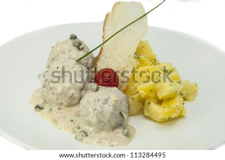 meatballs with potatoes on a white background