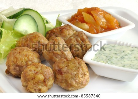 meatballs with vegetables and various sauces