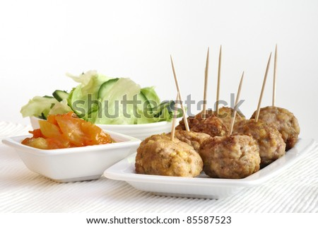 meatballs with vegetables on the white background