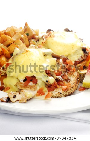 Meatl-over omelet with beans and potatoes against white background