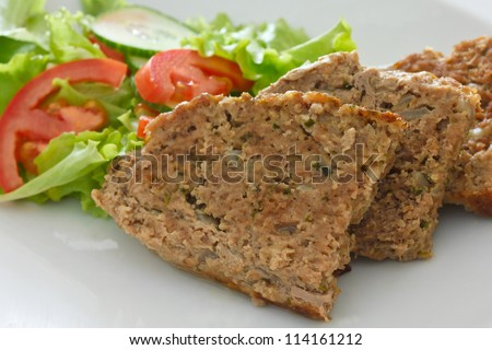 Meatloaf and salad - stock photo