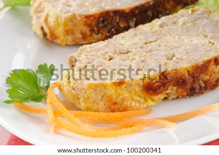 Meatloaf on white dish, closeup