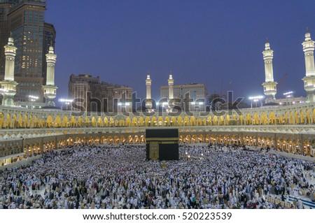 MECCA-FEB 20, 2012 : Muslim pilgrims circumambulate the Kaaba at sunset at Masjidil Haram in Makkah, Saudi Arabia. Muslims all around the world face the Kaaba during prayer time.