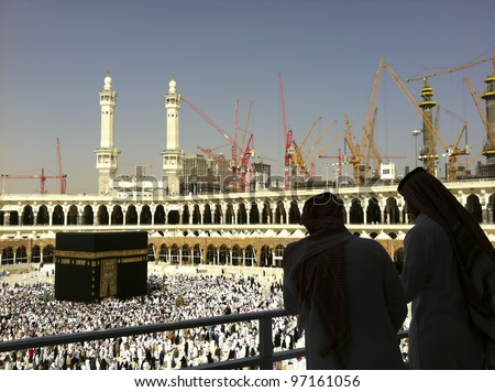 MECCA-FEB.26:Silhouette of unidentified Arabs & construction cranes in the background of Masjid Al Haram on Feb 26, 2012 in Mecca.Mecca currently in the process of expansion to cater for more pilgrims