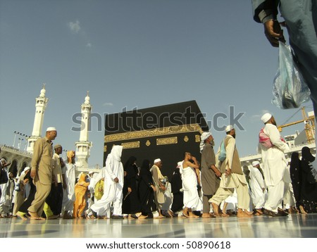 MECCA - JAN 2 : A close up view of Muslim pilgrims circumambulate the Kaaba from ground floor of Haram Mosque Jan 2, 2008 in Mecca. Muslims all around the world face the Kaaba during prayer time. - stock photo